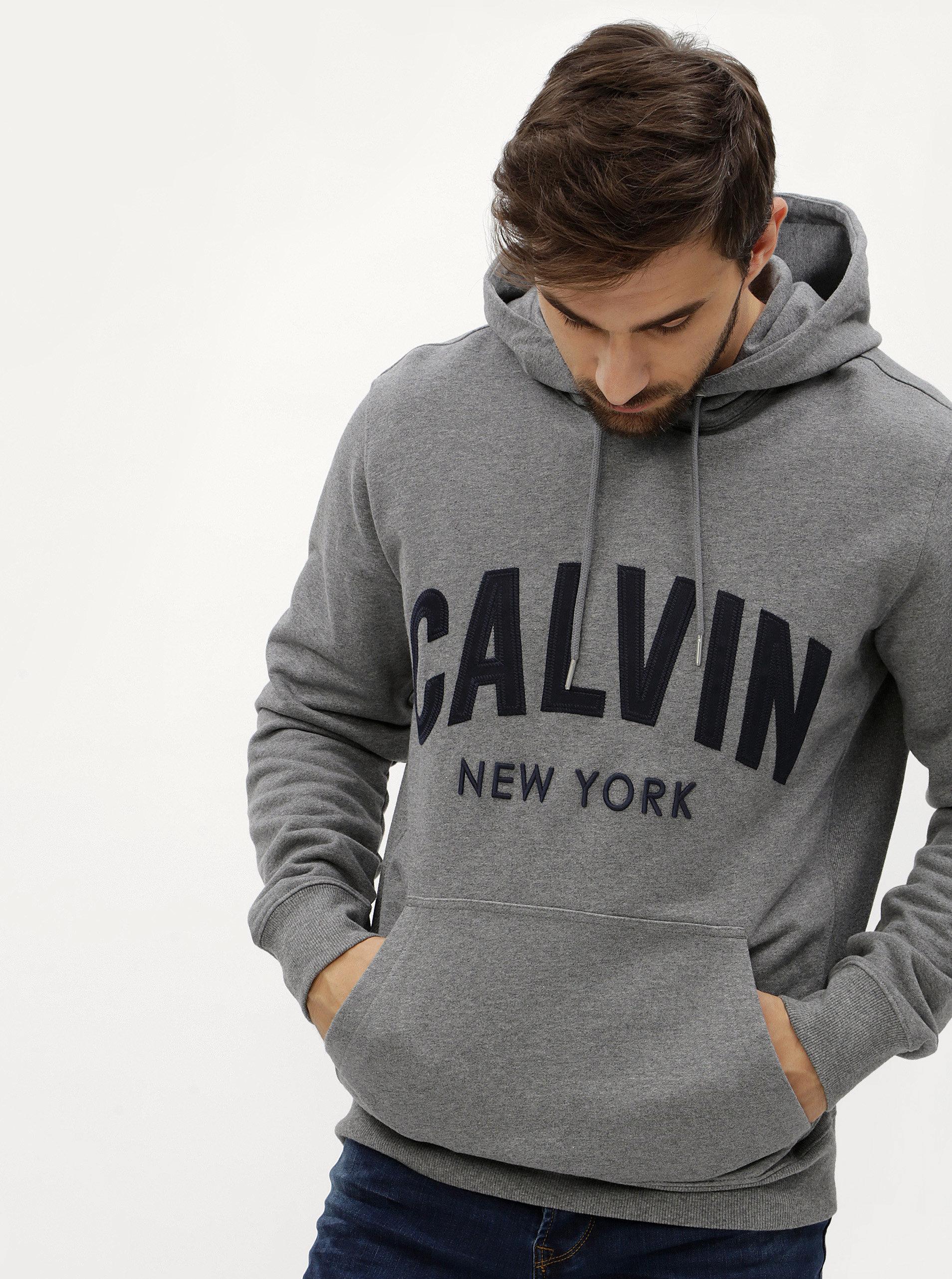 c025e4aa66 Šedá pánská mikina s kapucí Calvin Klein Jeans Hikos ...