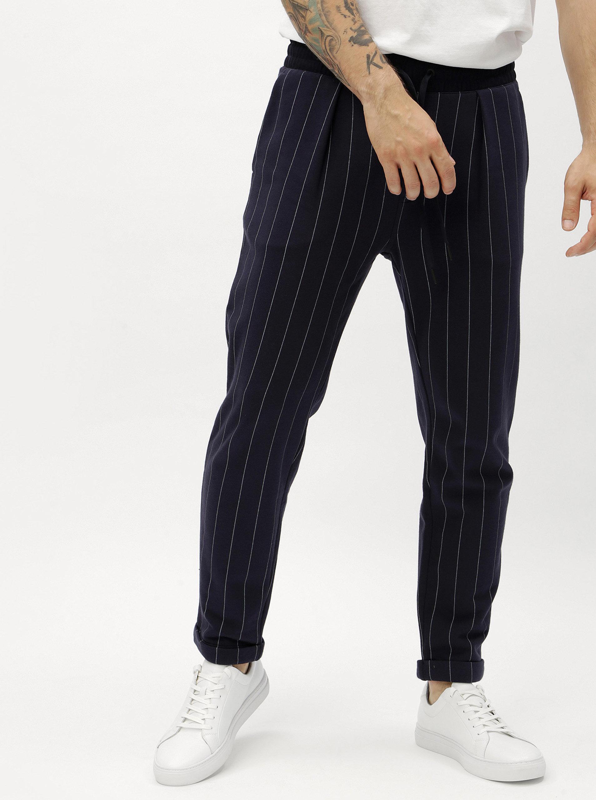 87ddc013ab4b Tmavě modré pánské pruhované tepláky Calvin Klein Jeans Hespero ...