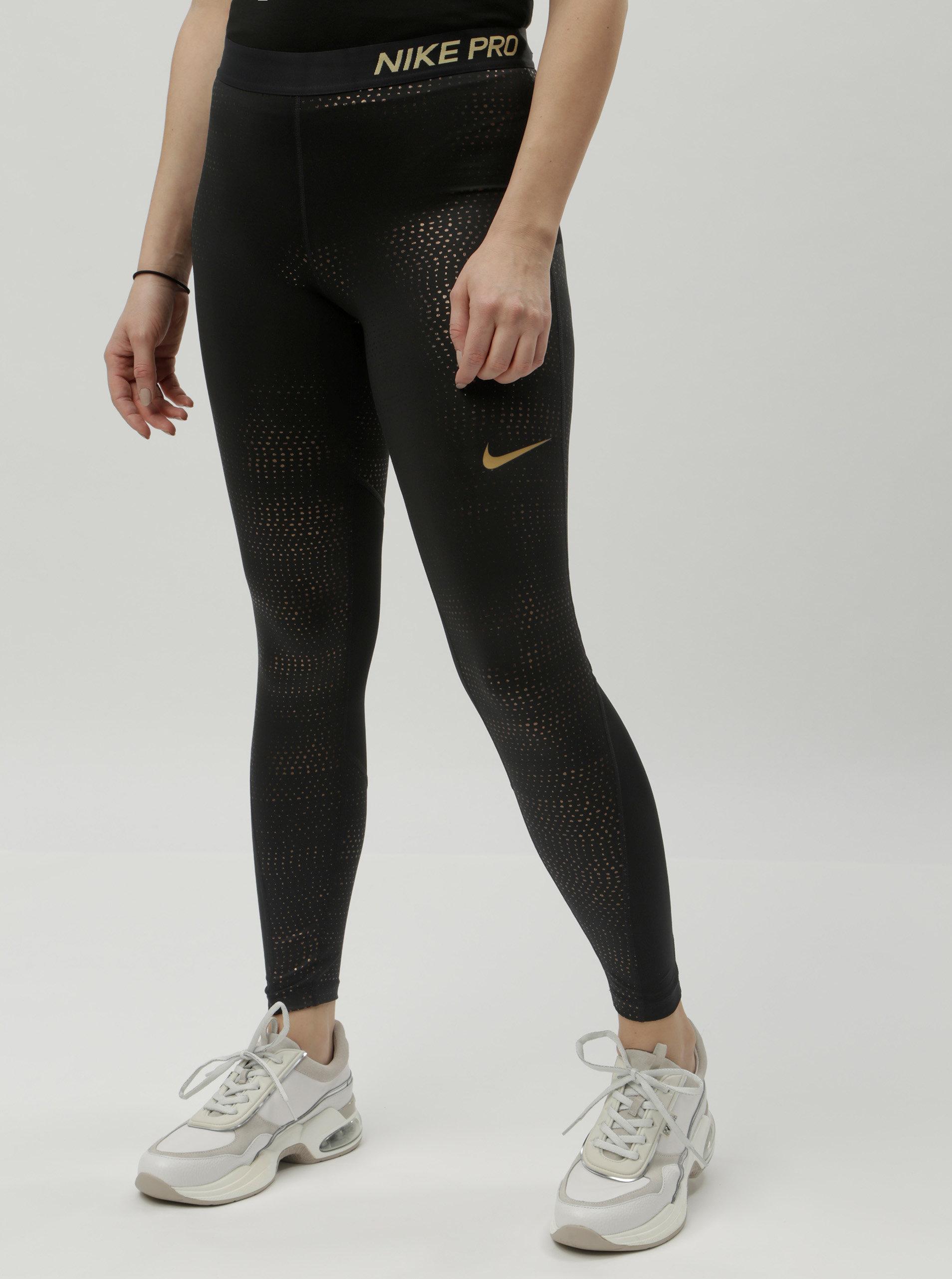 Černé funkční legíny s puntíky ve zlaté barvě Nike ... ca293b9e04