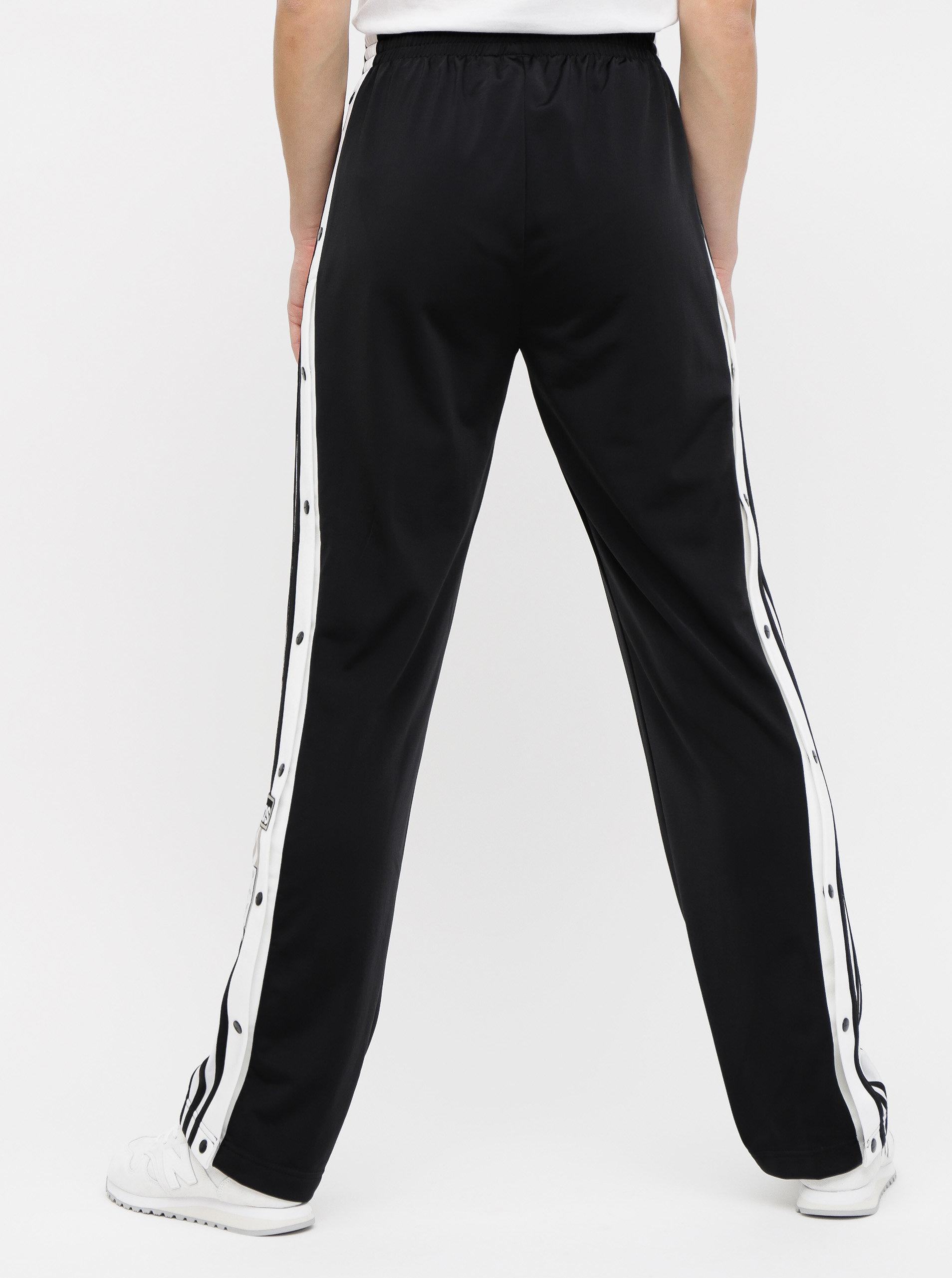 7e01182ffadf Čierne dámske tepláky s nášivkou adidas Originals Adibreak ...