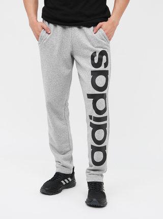 Světle šedé pánské žíhané tepláky s potiskem adidas CORE Brand